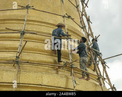 BANGKOK, THAILAND- JUNE, 23, 2017: close up of workers cleaning the chedi at wat saket temple in bangkok - Stock Photo