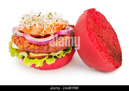 opened vegan burger with soy cutlet, tofu cheese, tomato sauce and microgreens - Stock Photo