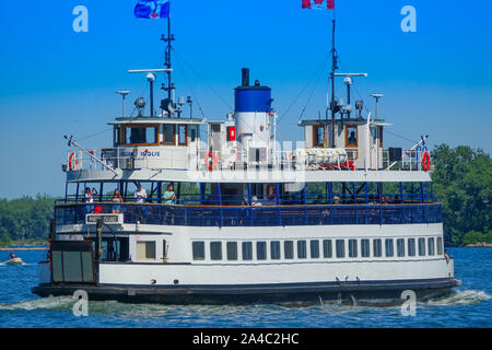 Toronto, Ontario, Canada-10 May, 2019: Toronto Islands Ferry bringing passengers to the Central Toronto Islands and Hanlan's Point - Stock Photo