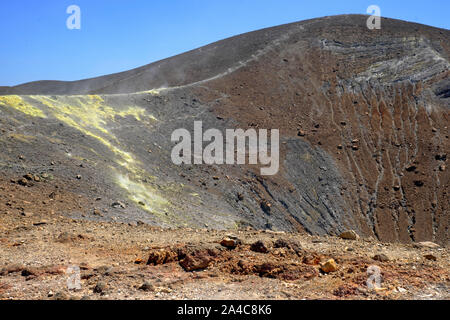 Sulfur fumaroles and chloride crusts on the crater rim of Gran Cratere on Vulcano Island, Aeolian Islands, Sicily, Italy. - Stock Photo