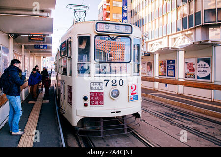 DEC 2, 2018 Hakodate, JAPAN - Hakodate city tram vintage streetcar at station near JR train station. The Tram well-established network throughout the - Stock Photo