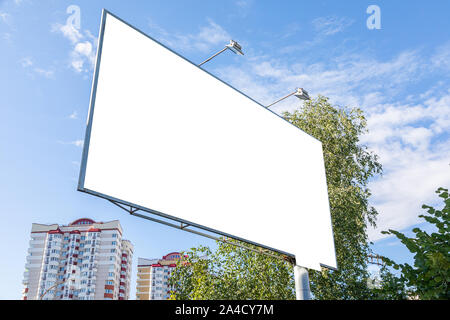 White blank billboard mock-up in dormitory district - Stock Photo