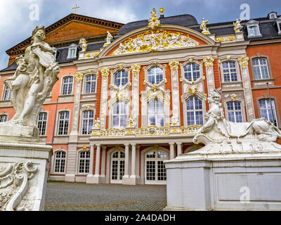 TRIER, GERMANY - OCTOBER 16, 2014: Statues of Apollo and a Sphinx by Ferdinand Tietz in front of the Electoral Palace, Kurfuerstliches Palais and the - Stock Photo