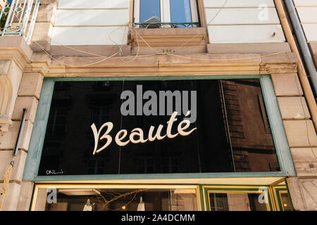 Strasbourg, France - Sep 21, 2019: Beaute translated as Beauty logotype on the old facade of clothes store in central Strasbourg - Stock Photo