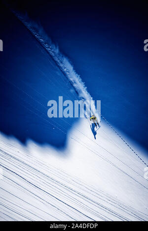 Aerial view of a man Backcountry Powder Skiing on Dachstein glacier, Austria - Stock Photo