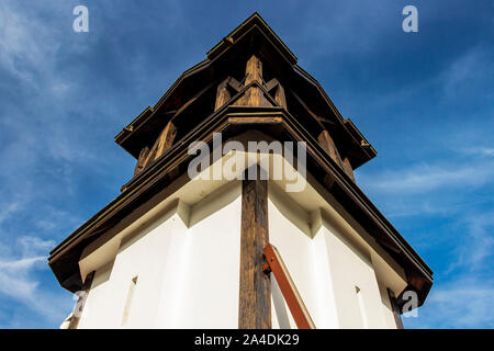 St. Petka Eastern Orthodox Church bell tower in Tsari Mali Grad fortress, the village of Belchin, Bulgaria, low-angle partial view - Stock Photo