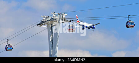 Emirates cable car crossing River Thames at North Greenwich British Airways jet aeroplane descending to land at nearby London City Airport England UK - Stock Photo