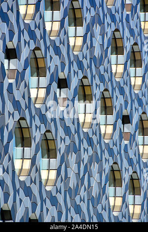 Abstract modern architecture background pattern & shapes formed of part external facade elevation of building design Greenwich London England UK - Stock Photo
