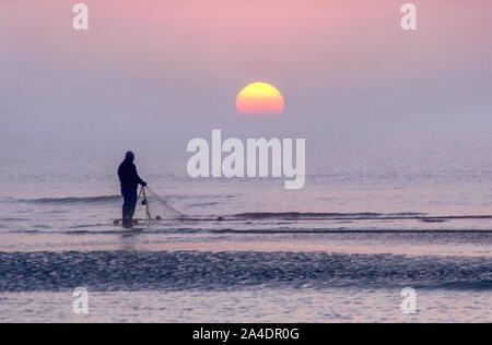 early morning fisherman - Stock Photo