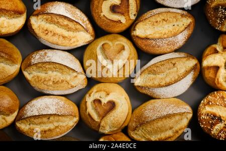 Huge choice of delicious fresh bread rolls. - Stock Photo