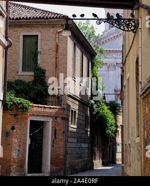 A view along a back street in the Sestiere of Castello, Venice. Looking towards the San Francesco Della Vigna Catholic Church.