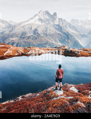 Amazing view on Monte Bianco mountains range with tourist on a foreground. Lac de Cheserys lake, Chamonix, Graian Alps. Landscape photography - Stock Photo