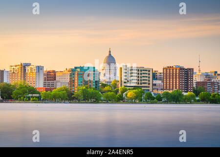 Madison, Wisconsin, USA downtown skyline at dusk on Lake Monona. - Stock Photo
