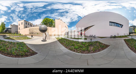 VILNIUS, LITHUANIA - MAY, 2019: Full spherical seamless panorama 360 degrees angle near facade of crooked modern building with huge mirrored glass in - Stock Photo