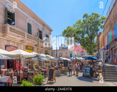 Bars, restaurants and cafes on El Caminito, a colourful street in La Boca district of Buenos Aires, Argentina - Stock Photo