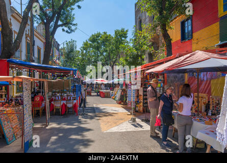 Market stalls and cafes on Magallanes, El Caminito, La Boca district, Buenos Aires, Argentina - Stock Photo