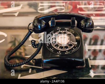 Old telephone with dust and scratches with vintage background, retro style concept - Stock Photo
