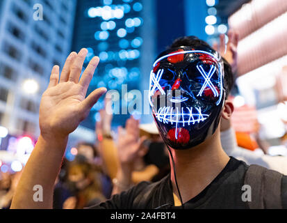 Hong Kong. 14th October 2019. Tens of thousands of pro-democracy demonstrators  attended a peaceful rally in Chater Garden in Central on Monday night, calling on the US to pass the Hong Kong Human Rights and Democracy Act of 2019 that would sanction officials who undermine people's rights in the Hong Kong SAR ( Special Administrative region). Many Stars and Stripes flags and pro-USA slogans were displayed by the demonstrators. Iain Masterton/Alamy Live News. - Stock Photo