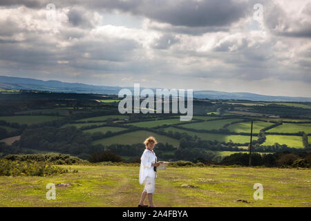 woman looking out over valley, towards cardinham wood, Bodmin Moor, Cornwall, - Stock Photo