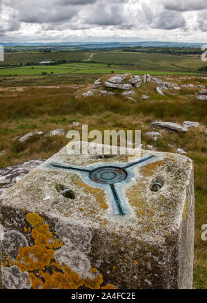 Hawks Tor ordinance survey stone, heavy sky, looking out over bodmin moor, - Stock Photo
