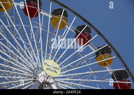 Santa Monica, California, USA, The solar powered Pacific Park Ferris wheel on Santa Monica pier oceanfront amusement park - Stock Photo