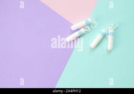 Flat lay composition with menstrual tampons on blue pink and lilac pastel background. Gynecology concept. Critical days pms period items - Stock Photo
