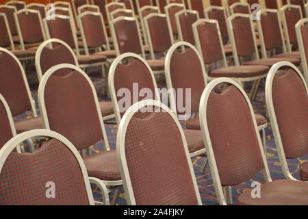 Group of brown chairs in rows - Stock Photo