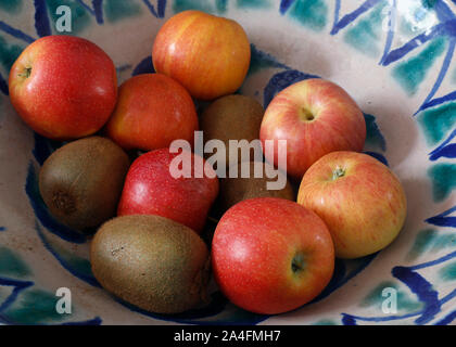 Bowl of fruit.  Apples and kiwis. - Stock Photo