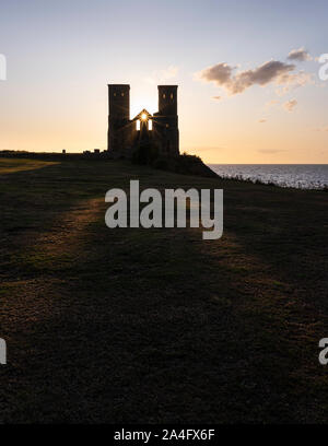 Late evening light at Reculver Towers; a medieval church and site of a Roman fort on the North Kent coast. - Stock Photo