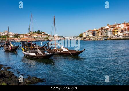 Vila Nova de Gaia, Portugal - September 13, 2019 - Traditional rabelos on the Douro River with Porto in the background. - Stock Photo