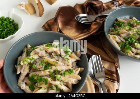 Cooked cream pasta with porcini mushrooms (Boletus edible) - Stock Photo