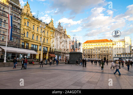 Tourists and locals on a scenic Ban Jelacic Square in the heart of Zagreb city centre, Croatia - Stock Photo