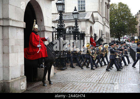 London, UK. 14th Oct, 2019. A band from the Royal Air Force march through Horse Guards before the state opening of Parliament, where Queen Elizabeth II delivers the Queen's Speech (written by the government). Members of the armed forces line the route to the Palace of Westminster, London, UK on October 14, 2019. Credit: Paul Marriott/Alamy Live News - Stock Photo
