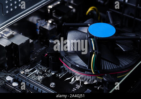 Close up photo with motherboard of computer and its fan. - Stock Photo
