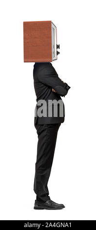 An isolated businessman stands in a side view with crossed arms and a TV box instead of his head. - Stock Photo