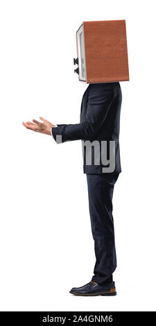 An isolated businessman stands in a side view with empty outstretched arms and a TV set replacing his head. - Stock Photo