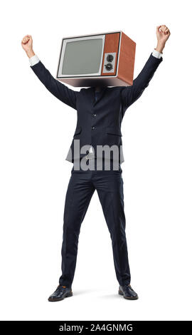 A happy businessman with arms raised in victory motion wears an old TV set instead of his head. - Stock Photo