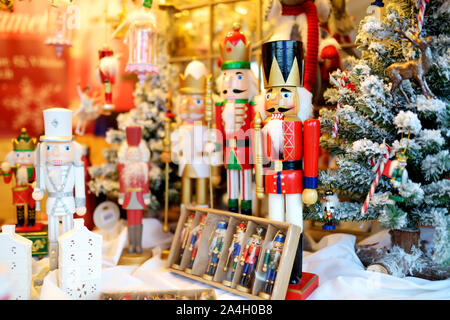 Christmas nutcrackers sold at Christmas market in Vilnius, Lithuania. Decorated and illuminated shopping stands with variety of Xmas toys. - Stock Photo