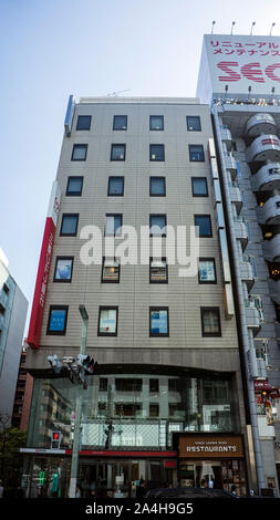 shopping mall ginza district narrow tall building restaurant - Stock Photo