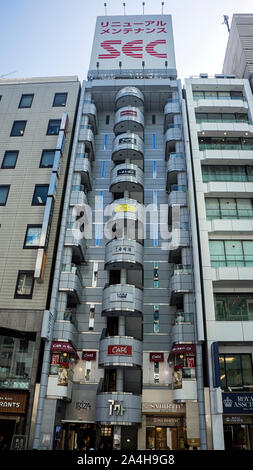 shopping mall ginza district narrow tall building - Stock Photo