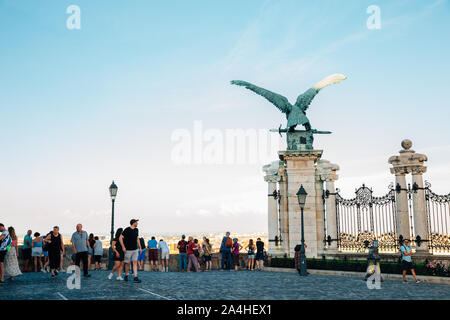 Budapest, Hungary - June 27, 2019 : Turul statue and tourist people at Buda Castle hill observatory - Stock Photo