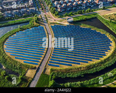 Solar Panel Farm with unique design in a form of an island (Zoneiland). Energy is used to power city heating (stadswarmte) in a modern sustainable dis - Stock Photo