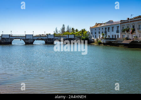 The impressive seven arched Roman bridge is one of the most popular landmark of Tavira, Algarve, Portugal - Stock Photo