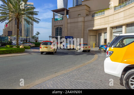 Dubai, UAE - December 2, 2018: Taxis in Dubai waiting for customers. - Stock Photo