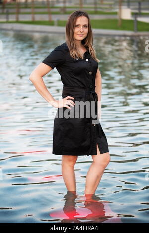 Girl standing in the water - Stock Photo