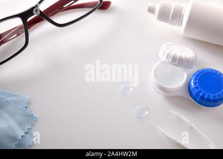 Various elements for vision correction on white table. Horizontal composition. Elevated view. - Stock Photo