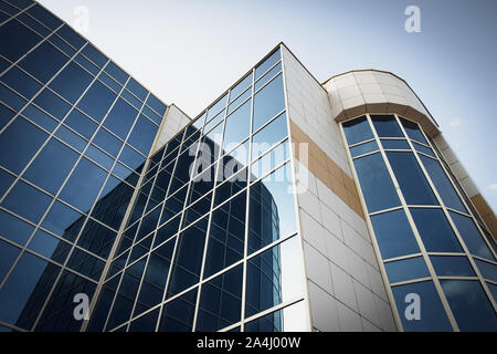 Blue skyscraper. Modern high-rise, reflection texture, facade background. Business center with blue windows. - Stock Photo