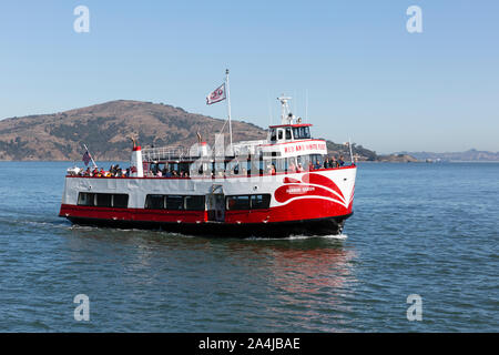 SAN FRANCISCO, USA - OCTOBER  2, 2019 : Sightseers on the Red and White Fleet cruise ship Harbor Queen as it sails across the  San Francisco bay. - Stock Photo