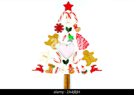 Minimalism Christmas tree decorated with cookies and festive ornaments on a white background. - Stock Photo