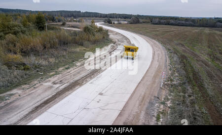 the truck transports the minerals from the top view from the drone - Stock Photo